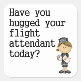 Tiene usted abrazado su asistente de vuelo pegatina cuadrada
