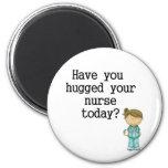 Tiene usted abrazado su enfermera imán para frigorifico