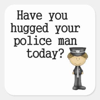 Tiene usted abrazado su hombre de la policía pegatina cuadrada