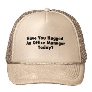 Tiene usted abrazado un administrador de oficinas  gorros
