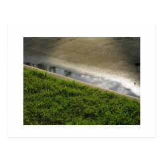 Tierra, agua, concreta postales