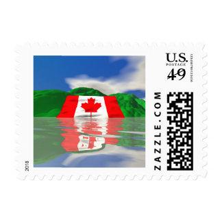 Tierra canadiense de la bandera franqueo