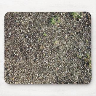 Tierra con las pequeñas piedras alfombrilla de ratón