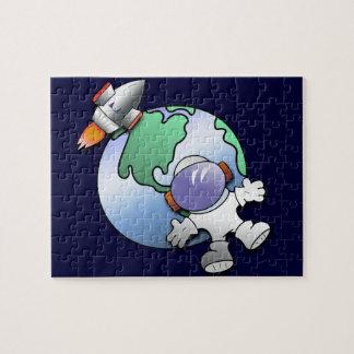 Tierra del astronauta y del planeta puzzle