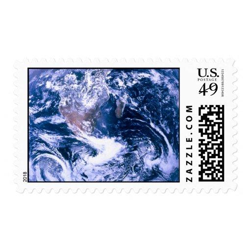 Tierra del mármol del azul del espacio timbre postal