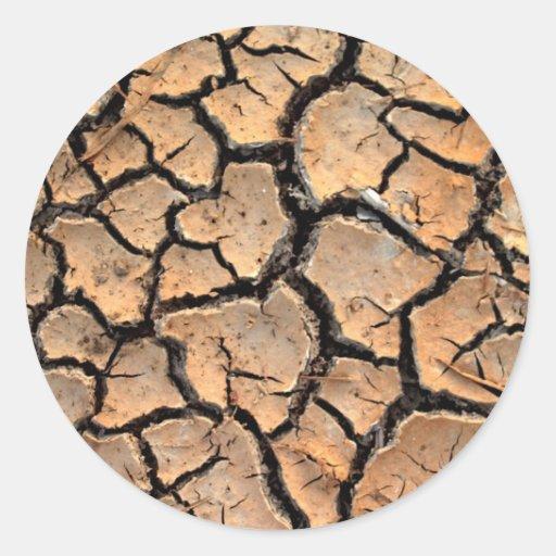 tierra del suelo seco/de la grieta etiqueta redonda