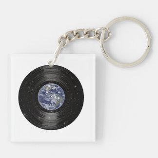 Tierra en el expediente de LP del vinilo del espac Llaveros
