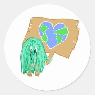 Tierra en forma de corazón del planeta pegatina redonda