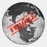 Tierra frágil etiqueta redonda