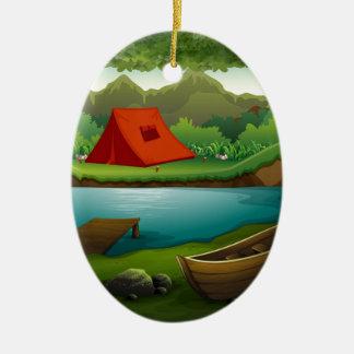 Tierra que acampa adorno navideño ovalado de cerámica