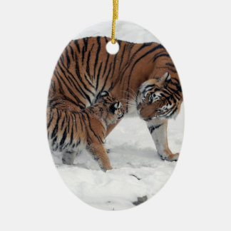 Tiger and cub in snow beautiful photo, gift Double-Sided oval ceramic christmas ornament