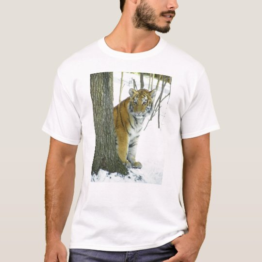 Tiger Cub In Snow Peeking Around Tree T-Shirt