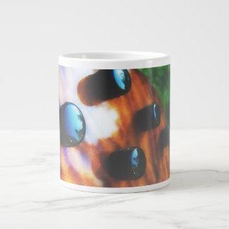 Tiger eye bass pickup knobs close up jumbo mug