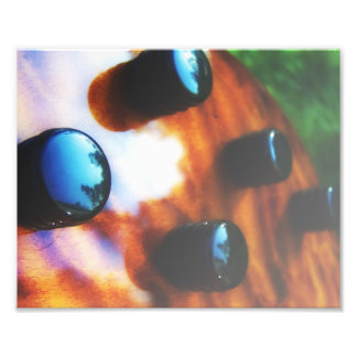 Tiger eye bass pickup knobs close up photo