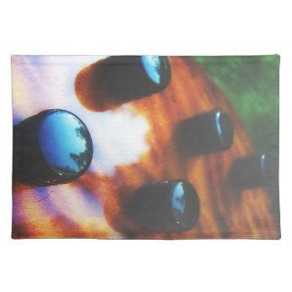 Tiger eye bass pickup knobs close up placemat