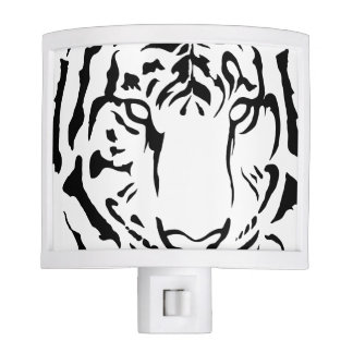 tiger eyes in black and white night light