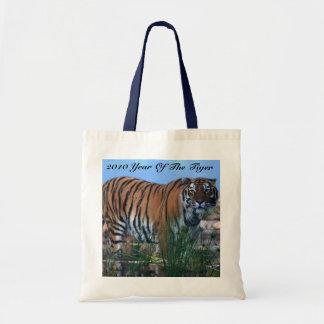 Tiger guarding the river tote bag