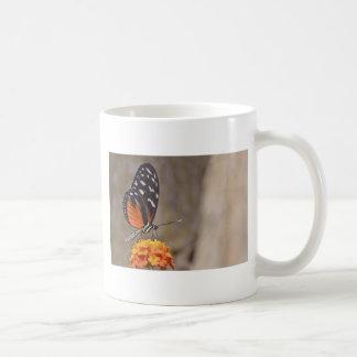 Tiger Longwing butterfly feeding on flower Mug