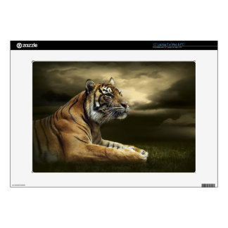Tiger looking and sitting under dramatic sky laptop skin