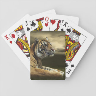 Tiger looking and sitting under dramatic sky poker deck