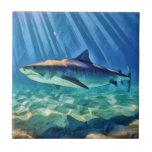 "Tiger Shark Ceramic Tile<br><div class=""desc"">Tiger shark under sunbeams in turquoise waters.</div>"