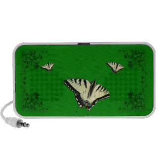 Tigre Swallowtails en altavoz verde