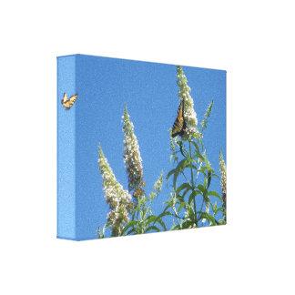 Tigre Swallowtails en la mariposa Bush Impresion En Lona