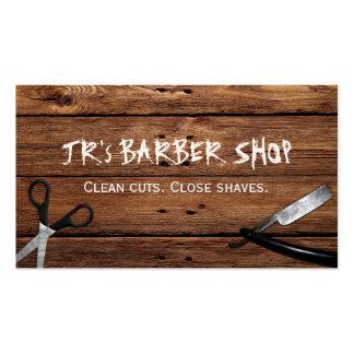 Tijeras y maquinilla de afeitar rústicas de la tarjetas de visita