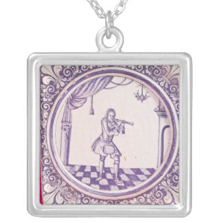 Tile depicting a clarinetist, 1706 silver plated necklace