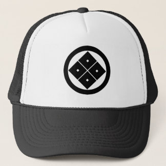 Tilted four-square-eyes in circle trucker hat