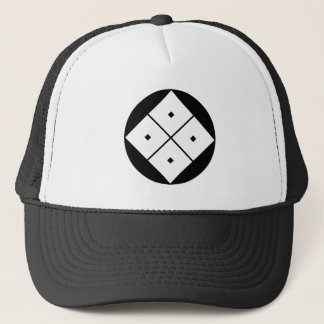 Tilted four-square-eyes in rice cake trucker hat