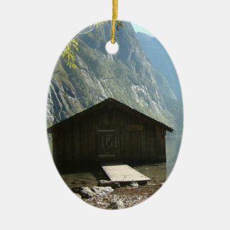 Timber house by a lake ceramic ornament