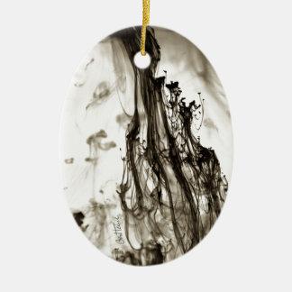 Tinta abstracta en agua adornos de navidad