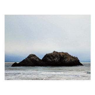 Tiny island in sea postcard