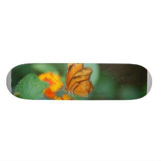 Tiny Orange Butterfly Skateboard