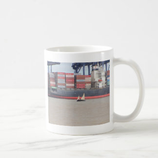 Tiny Yacht  And Huge Container Ship Coffee Mug