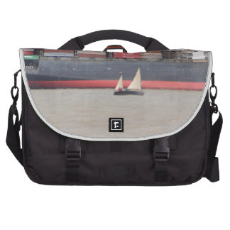 Tiny Yacht  And Huge Container Ship Laptop Bag