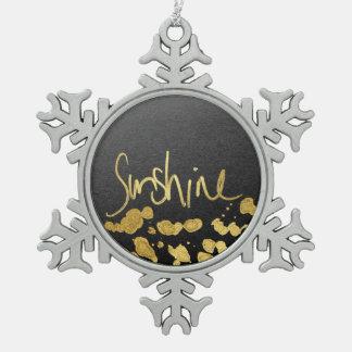 """Tipografía de la """"sol"""" y oro de la salpicadura de adorno de peltre en forma de copo de nieve"""