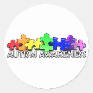 Tira del rompecabezas de la conciencia del autismo pegatina redonda