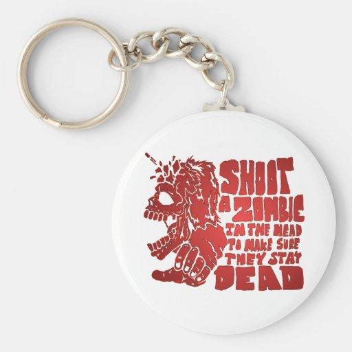 Tire a un zombi en la cabeza llavero redondo tipo pin