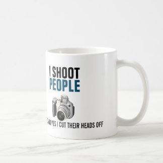 Tiro a gente y corto a veces sus cabezas taza de café