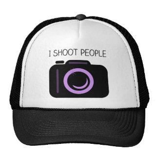 Tiro decir divertido del fotógrafo de la gente gorras de camionero