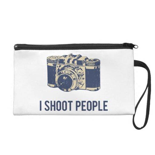 Tiro la cámara de la fotografía de la gente