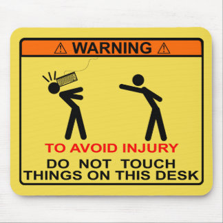 TO AVOID INJURY, DO NOT TOUCH THINGS ON THIS DESK MOUSE PAD