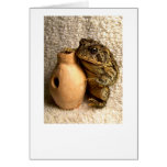 Toad frog holding miniature udu photograph greeting card
