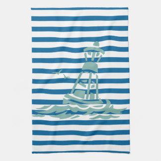 Toalla azul y blanca de la boya del océano de la