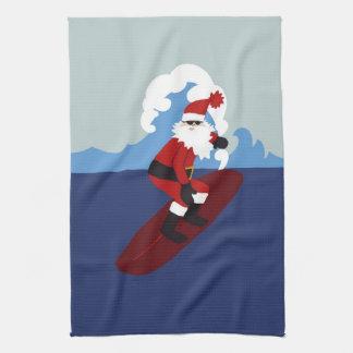Toalla de cocina de Santa que practica surf
