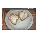 Toasted bread with butter in a plate travel accessories bag