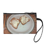 Toasted bread with butter in a plate change purses