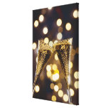 Toasted champagne flute, close-up canvas print